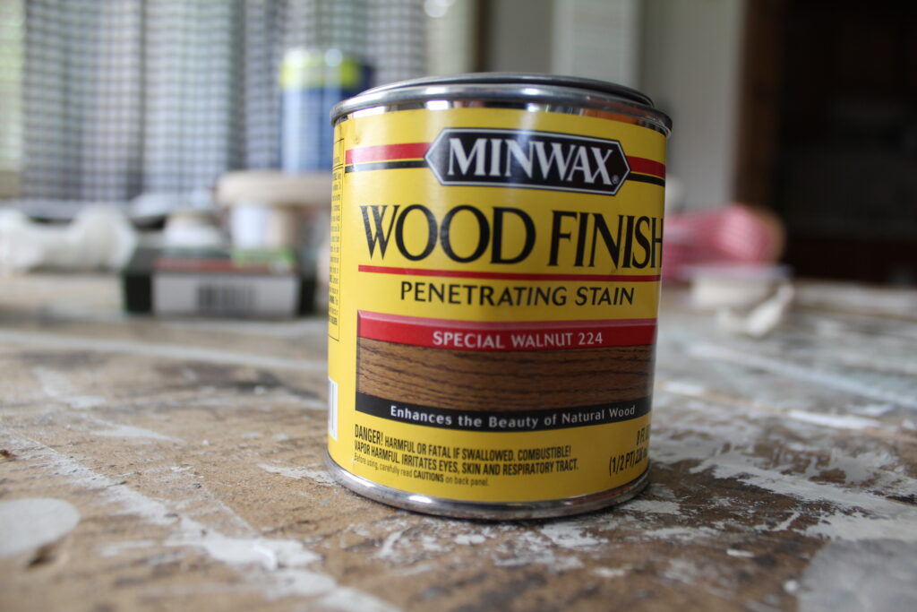 can of minwax wood stain on a piece of cardboard