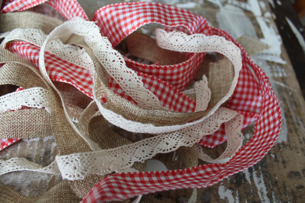 pile of ribbon, burlap and red gingham textures