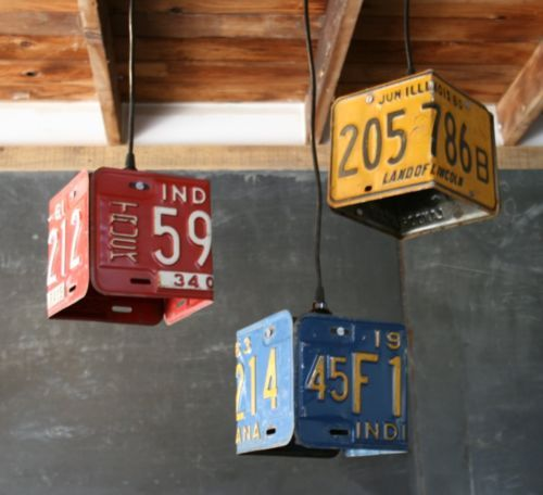license plates bent and hanging from a pendat wood ceiling