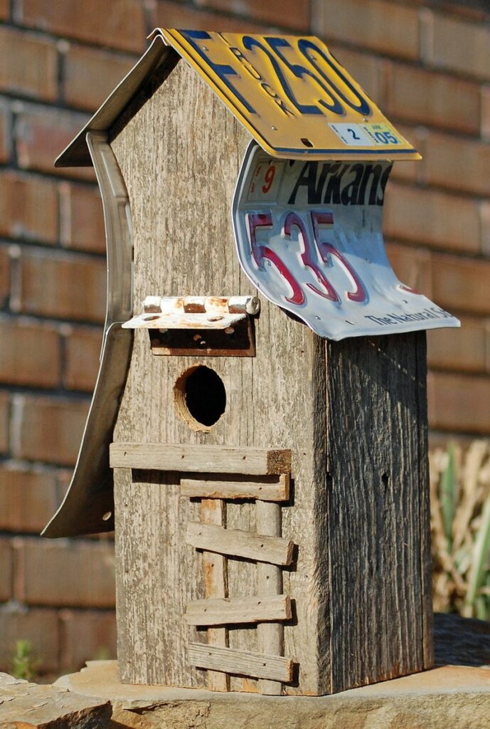 license plate birdhouse with rusty hinge dormer and barnwood