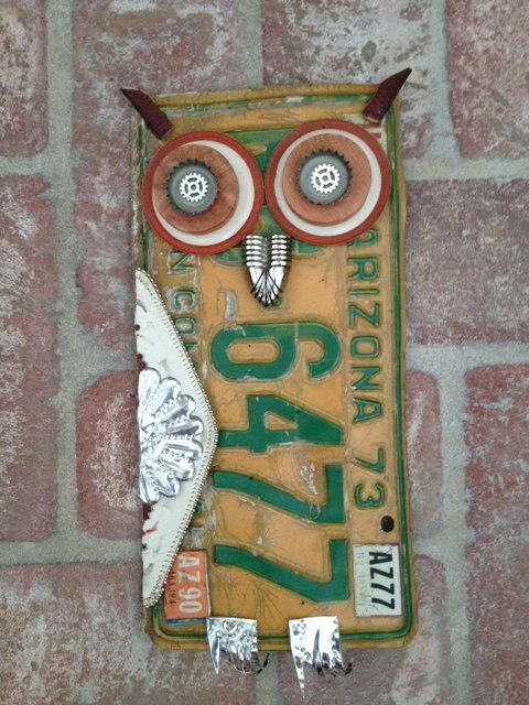 License plate owl on a brick background