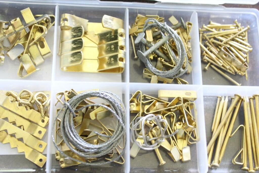 Picture hsngin kitneoth brass nails, hooks and hanging supplies