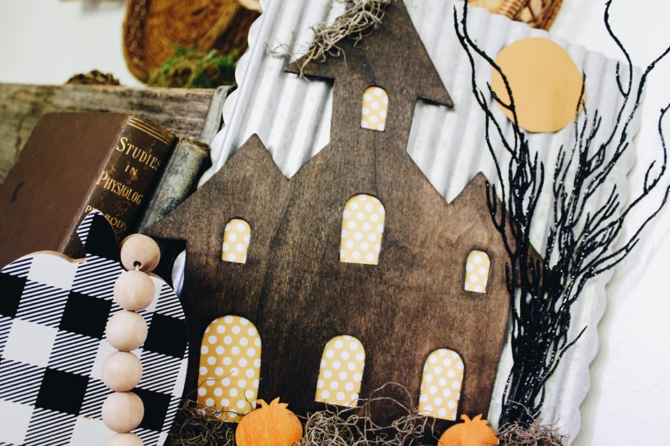 fhaunted house dollar tree project with spooky twigs and orange pumpkins