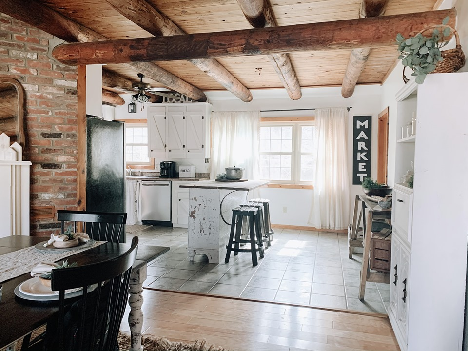 farmhouser kitchen with beams and white cabinets
