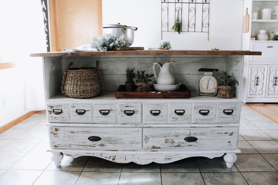 rustic dresser converted into an island in a farmhouse kitchen