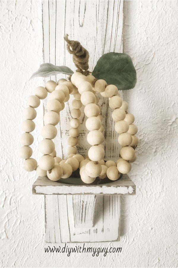 wood beads on wire in the shape of a pumpkin