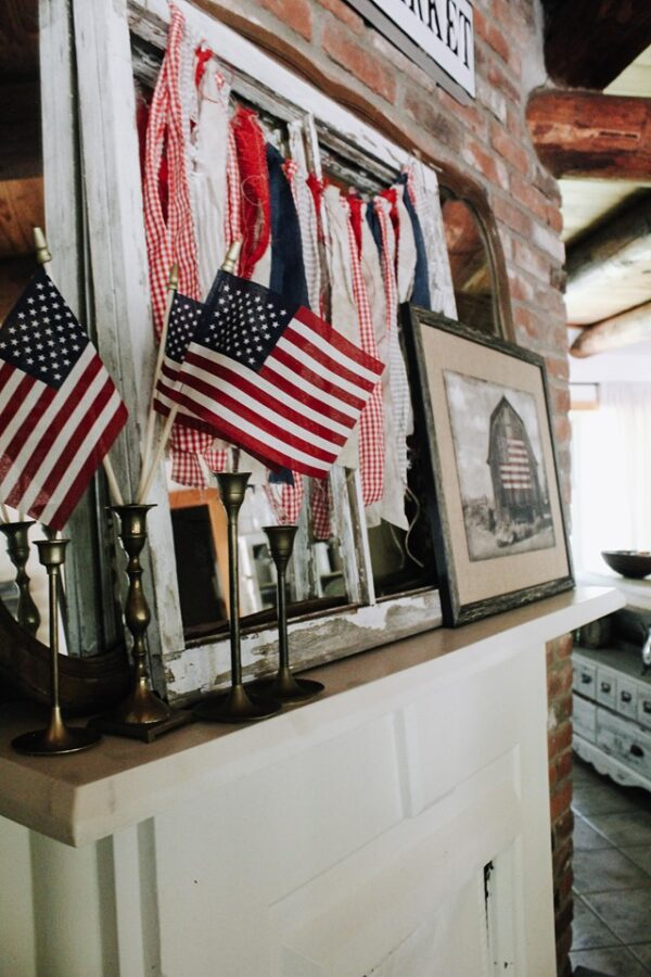 AMERICAN FLAGS AND SCRAP FABRIC BANNER ON MANTLE