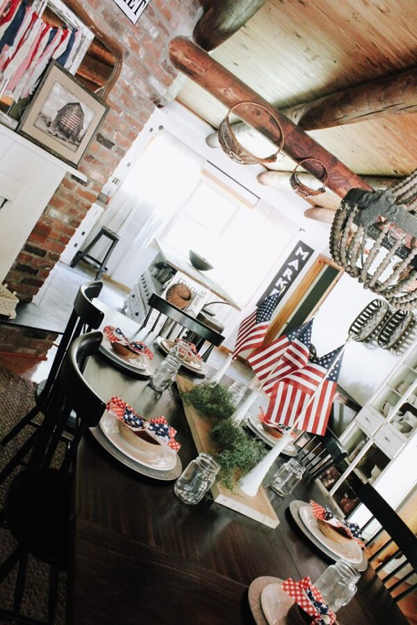 PATRIOTIC TABLESCAPE WITH BRICK FIREPLACE AND WOOD BEAMS