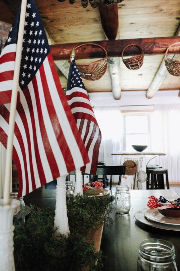 AMERICAN FLAG IN MILK VASES WIOTH WOOD CEILING BACKGROUND