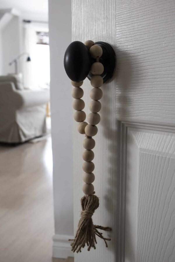wood bead tassel hanghing on door knob