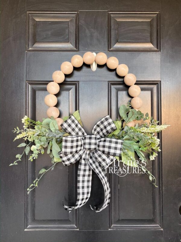 jumbo wood beads in wreath form with buffalo check ribbon and greenery