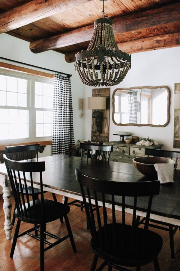 dining room table with mirror and shutters in the backgroound