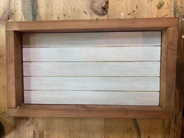 whote shiplap sign with brown frame