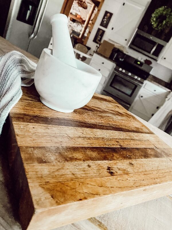wood cutting board with marble mortar and pestal
