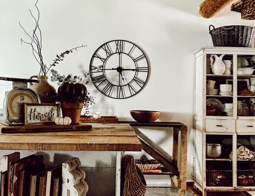 rustic fall vignette with warm tones and large metal clock