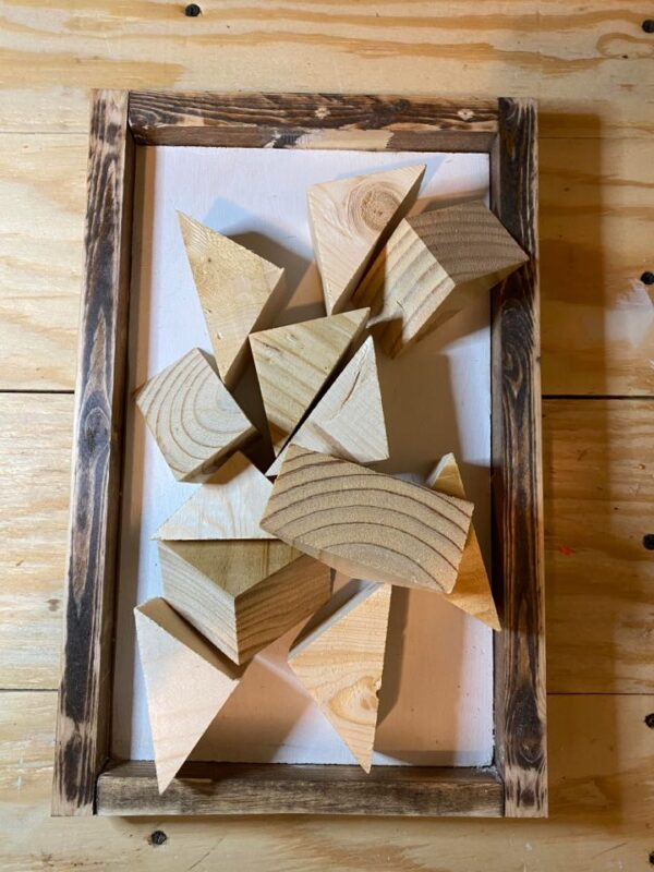 scrap wood triangles and rustic farmhouse sign