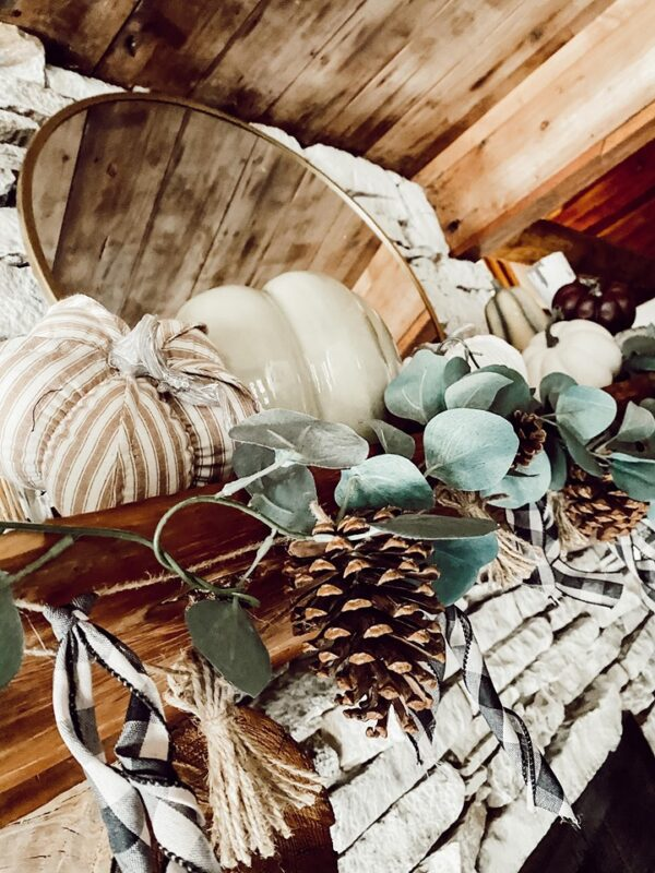 pine cone and euclyptus garland on rustic mantle