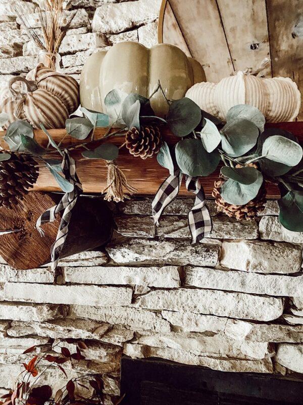 buffalo check garland with eucalyptus and pumpkins