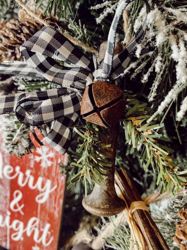 rustic wood peg ornament DIY with buffalo check ribbon