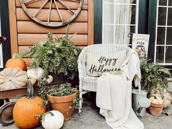 vintage wicker chair with pumpkins and ferns