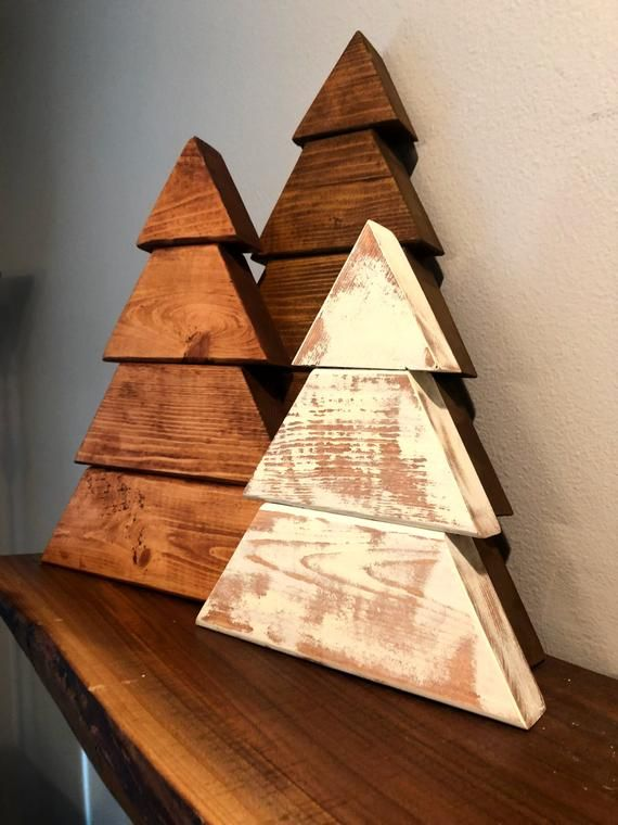 stained wood christmas trees and rustic, chippy white farmhouse christmas tree