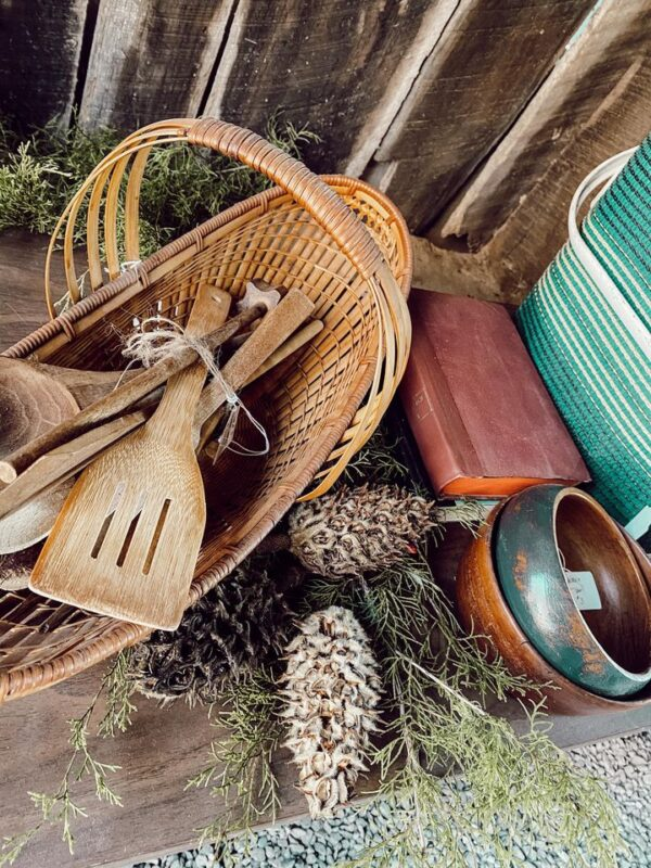 wicker bowl and wooden utensils