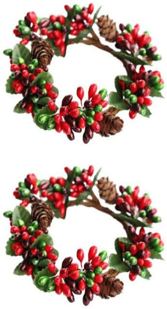 candle rings with red berries and pine cones for embellishing the diy sled