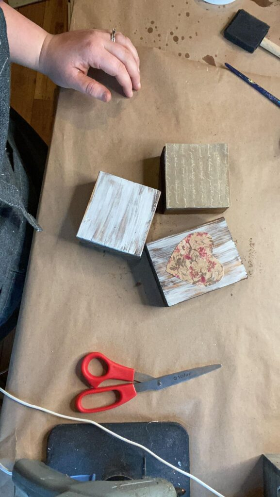 Wood blocks with scrap book paper attached