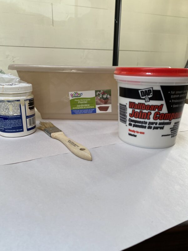 supplies needed for faux french pottery DIY joint compound and dollar tree plastic container