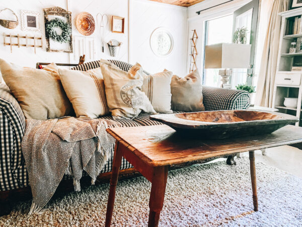 rustic living room decor with buffalo check couch and gallery wall