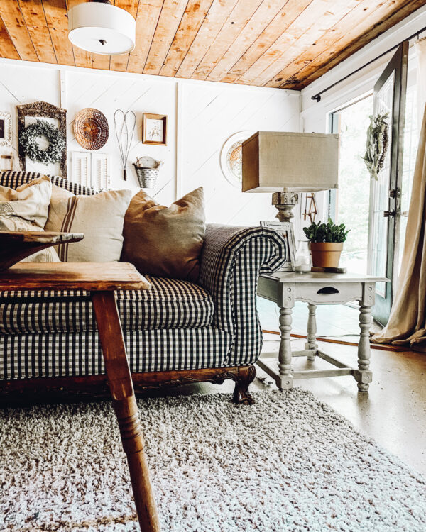 rustic living room decor with buffalo check couch and wood coffee table