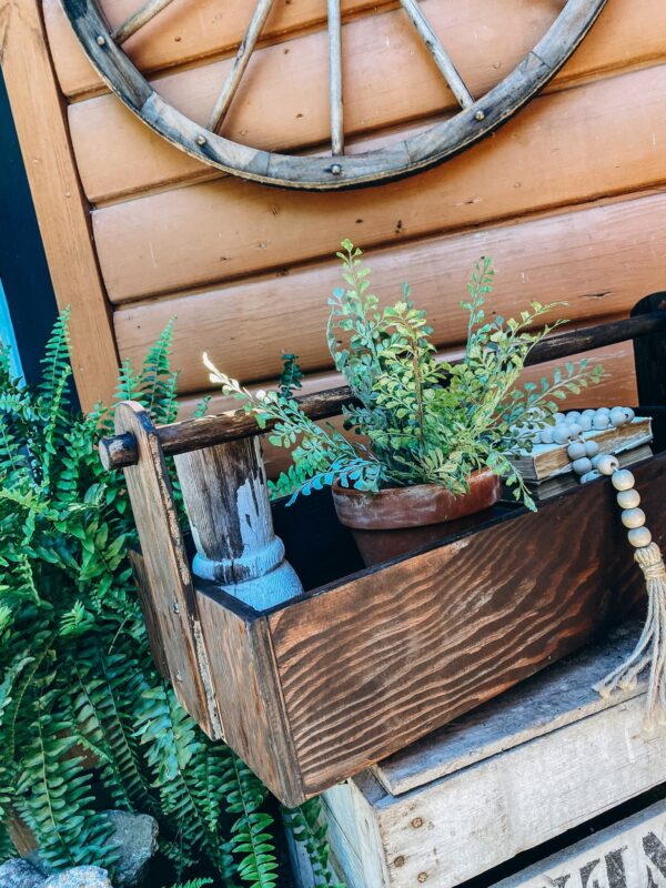 The Home Goods Market Old ToolBox Restoration sitting on a bench styled with weathered rustic wood antiques hand picked by R+R
