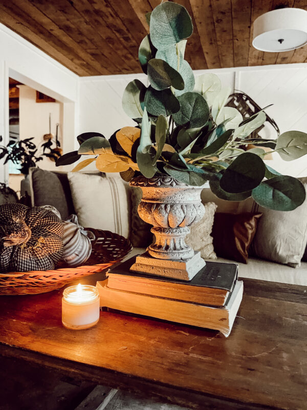everyday french farmhouse diy urn with old books and pumpkins