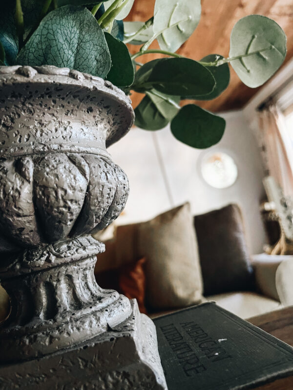 thrifted urn with silver dollar eucalyptus