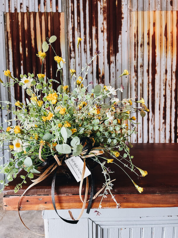 wildflower arrangement with rusty metal wall background